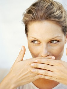woman-covering-mouth-mdn