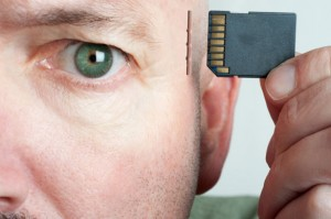 man-inserting-memory-card-in-brain