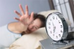 2365-woman_reaching_for_alarm-12